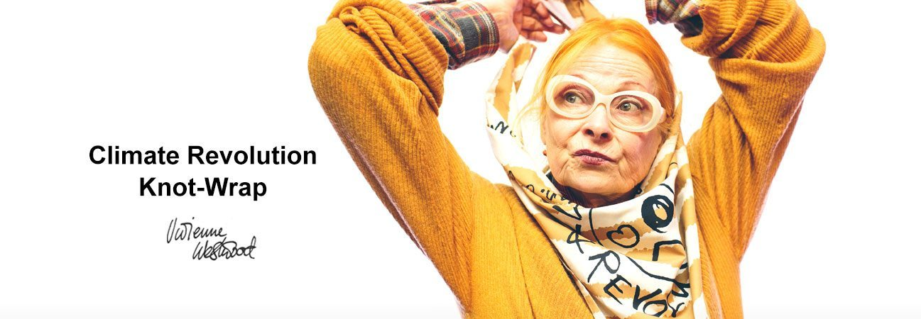 Photo of Vivienne Westwood in a gold sweater and yeloow and white printed scarf with her arms above her head, and the words Climate Revolution Knot Wrap