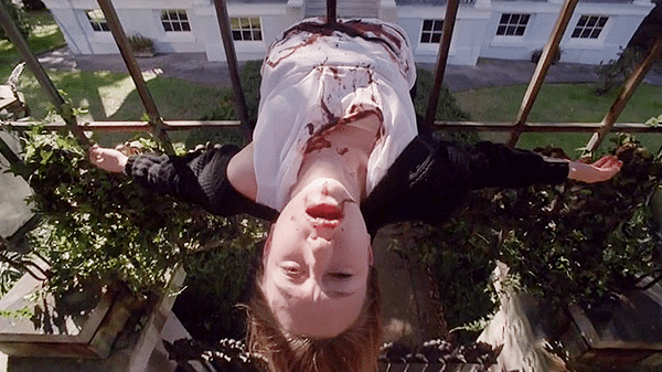 "Screencap of Zoe impaled on a fence spike in American Horror Story episode 3x13, ""The Seven Wonders"""