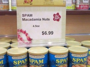 Cans of Spam-flavored macadamia nuts at Hilo Hattie for $6.99 apiece.