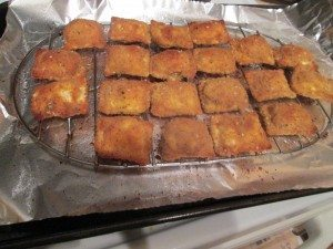 Breaded ravioli, golden brown from the oven.