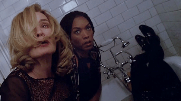 "Marie Laveau (Angela Bassett) and Fiona Goode (Jessica Lange) in American Horror Story: Coven episode 3x10, ""The Magical Delights of Stevie Nicks."""