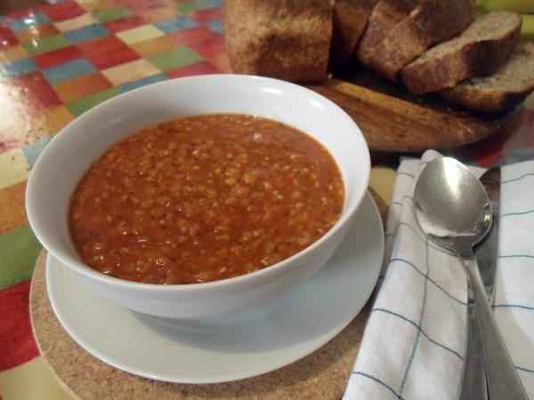 A picture of a bowl of spicy tomato lentil soup.