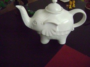 A picture of a teapot shaped like an elephant.