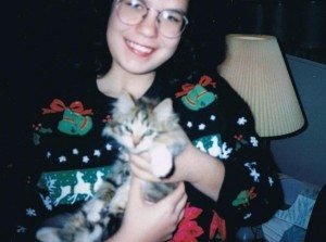 A picture of a woman holding a kitten.