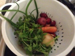 Vegetables in strainer.