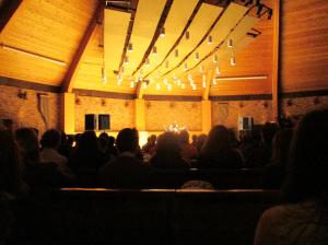 Agnes Flanagan Chapel. Musician Jason Webley onstage.