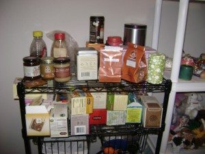 A picture of many different kinds of tea on a shelf.