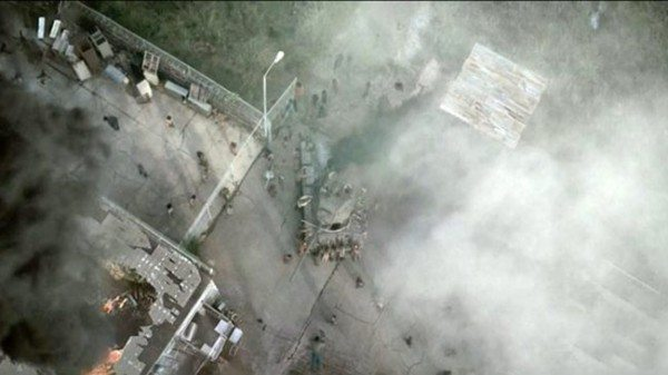 Ariel view of the destroyed prison overrun by zombies