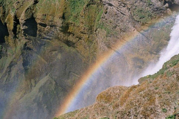 Look, an Icelandic rainbow, next to a waterfall too! Things are getting better. (Photo in public domain.)