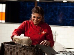 Chef Fatima Ali opens her basket on the Food Network show Chopped.