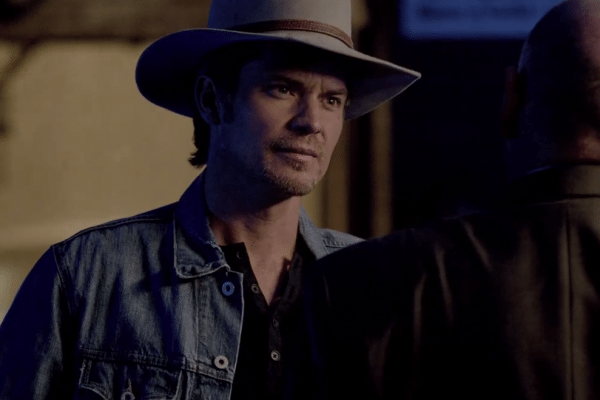 Timothy Olyphant as Raylan Givens, just before he's punched by Art