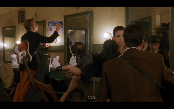The best part about rewatching movies, is that you notice things you didn't notice before.  For example, why is Faye laying across the table to brush Jimmy's hair?