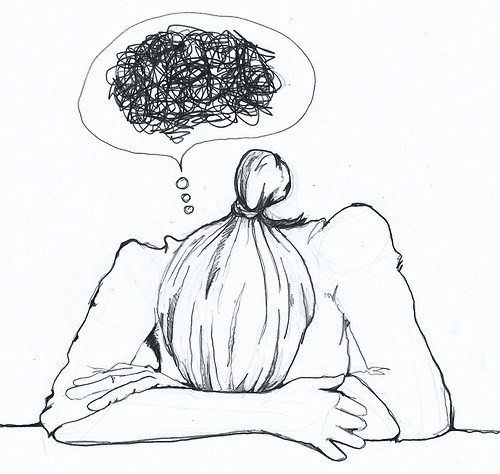 Picture of person, with head faced down on a desk, with a caption bubble filled with scribbles.