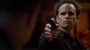 Boyd Crowder, holding a gun on everyone!