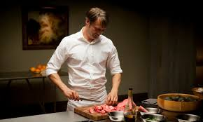 Mads Mikkelsen as Hannibal cutting up meat.