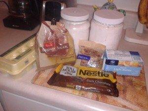 photo of ingredients for blondies: flour, sugar, chocolate chips, nuts, eggs and butter