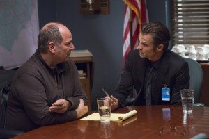 Raylan and Picker have a private chat in the US Marshal's office.