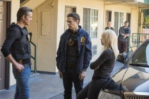 Candace, Raylan and Tim Gutterson having a conversation outside the hotel where Candace was rescued