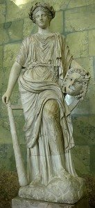 A Roman sculpture of Melpomene, a woman in a draped outfit holding a severed head.