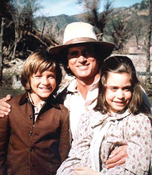 Charles Ingalls and two of his passel of orphans, from Little House on the Prairie