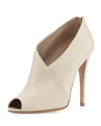 Can Olivia really break some heads with these asymmetric peep-toe booties in Sand? Maybe not, but neither she or I are made of stone, you heartless monsters. (Photo credit: Neiman Marcus.)