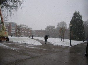 Oregon State University students use umbrellas to deal with the snow.