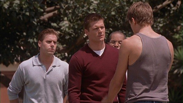 Graham and soldiers confront Riley on the basketball court.