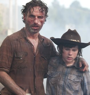 Carl and Rick escaping from the prison.