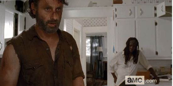 Rick is beat up and tired while Michonne talks to him.