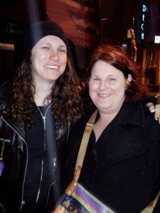 A picture of Laura Jane Grace (Against Me!) posing with a fan.