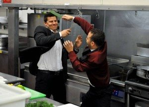 Booth fighting with Horatio in the restaurant kitchen