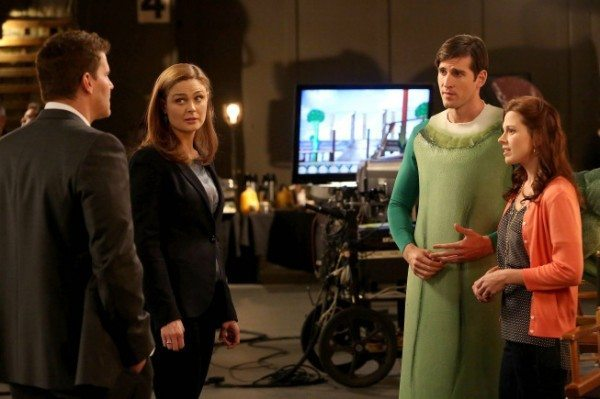 Booth and Brennan talk to a guy dressed as a stalk of celery