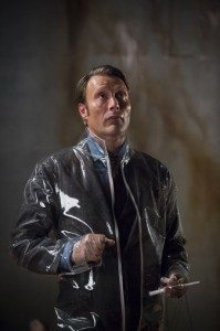 Hannibal is in a plastic suit and stares up.
