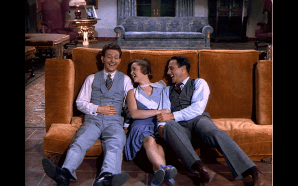 Cosmo, Kathy, and Don collapsed laughing on the tipped couch