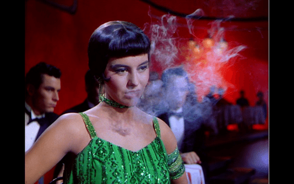 Cyd Charisse in a green dress, smoking