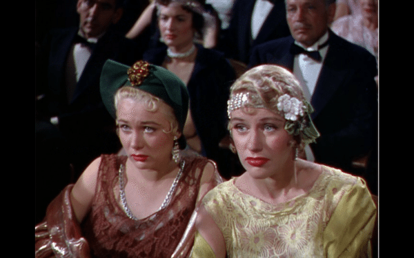 Two morose-looking women in the audience