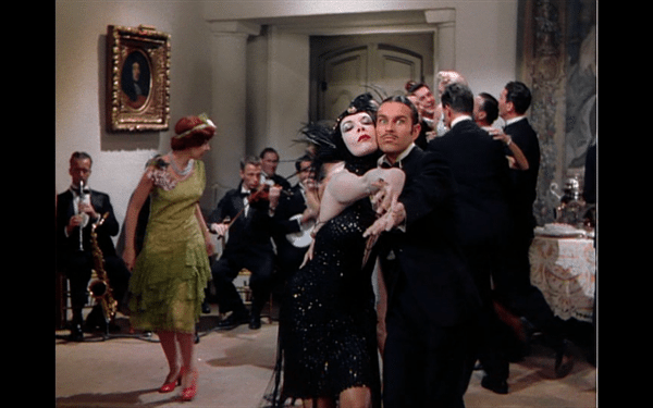 A very dramatic tango between a woman in a spidery dress and a man with slicked-back hair