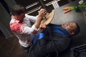 Hannibal Is trying to stab Jack with a knife