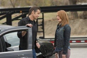 Raylan and Wendy Crowe standing next to a car.