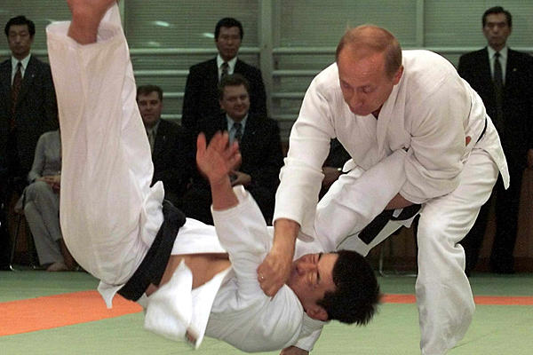 Putin is dominating somebody else in Taekwondo