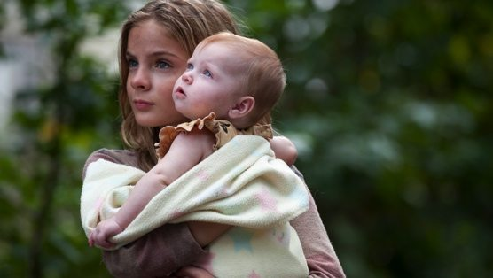 Lizzie takes care of Judith.  How nervous does this picture make you on a scale of 1-10? (Photo credit: AMC TV.)