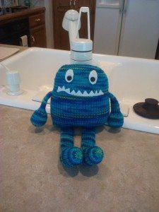 a blue hand-knitted monster from CraftyJHawk