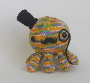 a multicolored hand-knitted octupus from CraftyJHawk
