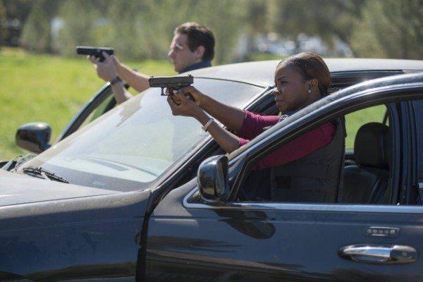 Tim and Rachel with guns drawn at their car