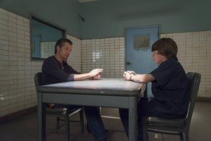 Raylan and Kendall talking in a prison holding cell
