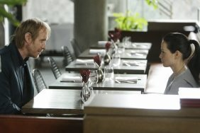 Mycroft and Joan sitting at a table in Diognes