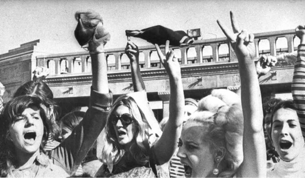 Photo from Miss America pageant protest in 1968. Women holding up bras.