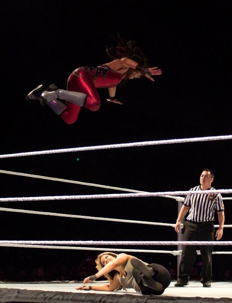 Wrestler flying in mid air