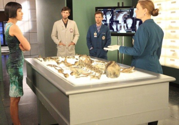Brennan and team examining the bones of the victim