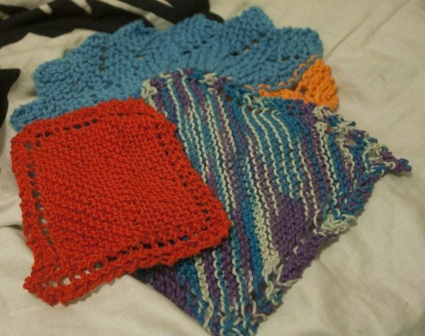 A picture of a stack of hand knit washcloths.
